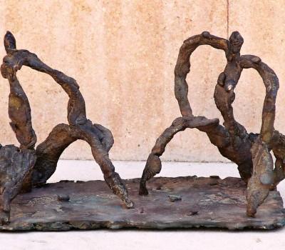 Pareja sentada – Artes Metálicas